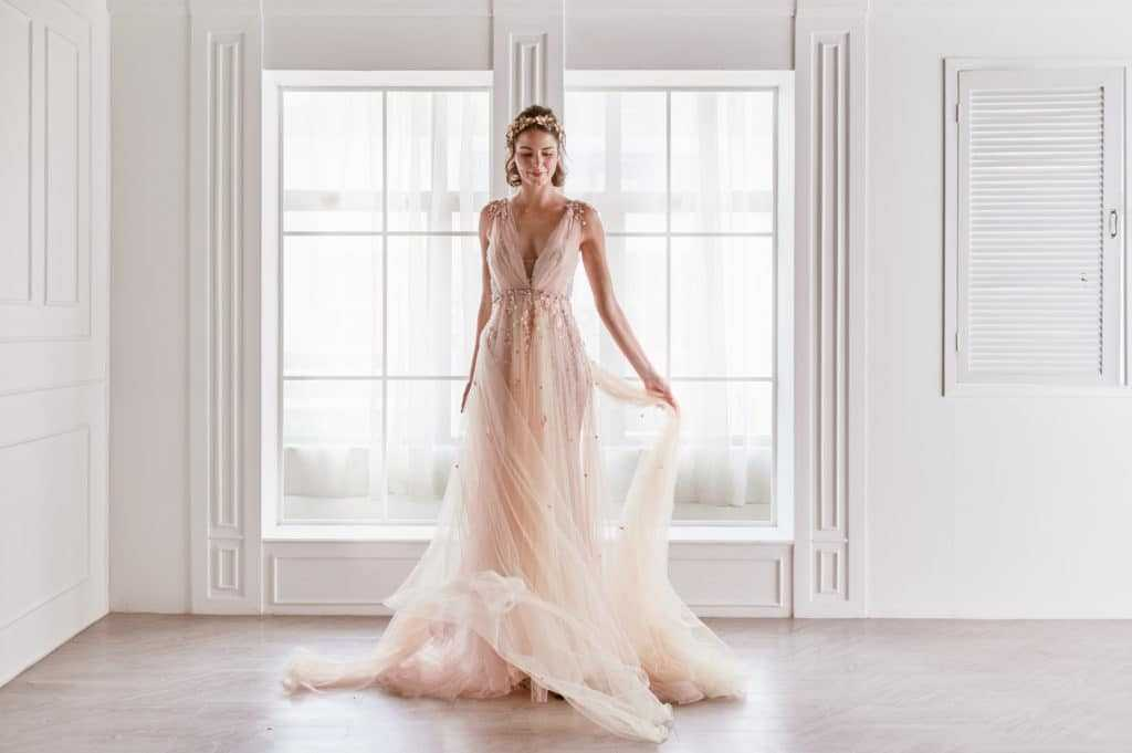 Deana draped tulle overlay - One Dress, Many Looks! - The National Wedding Directory